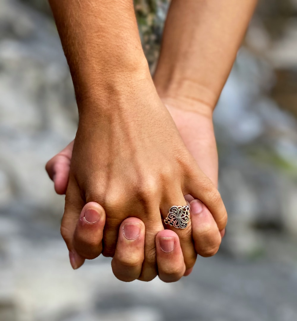 person wearing gold diamond ring