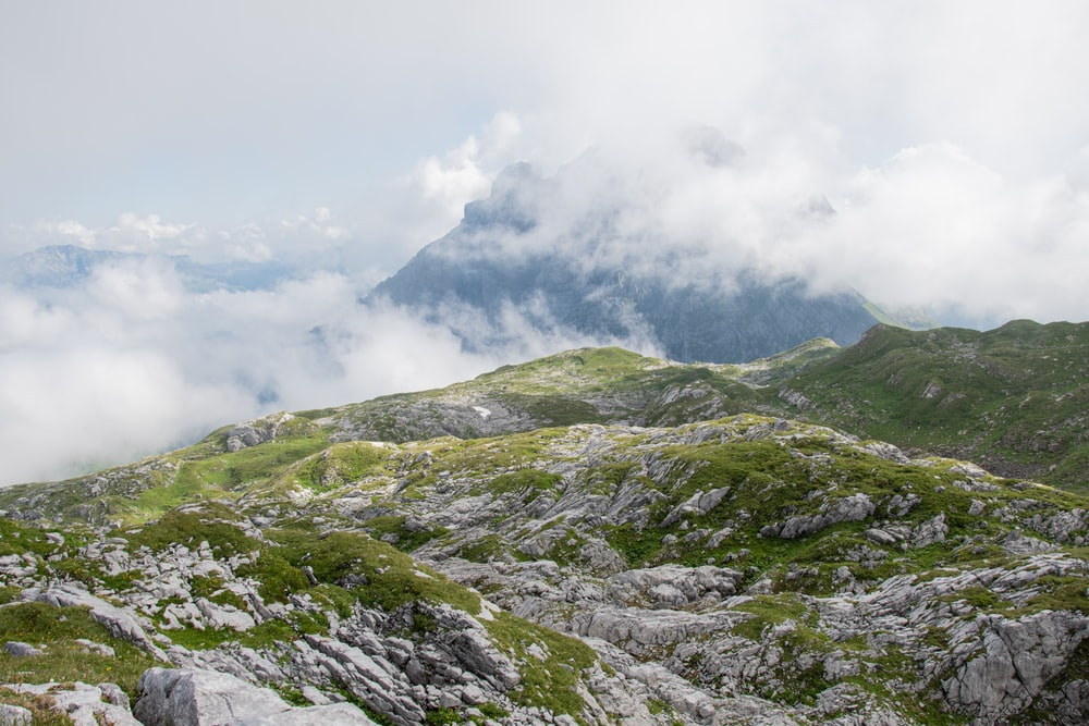 green and gray mountain under white clouds during daytime