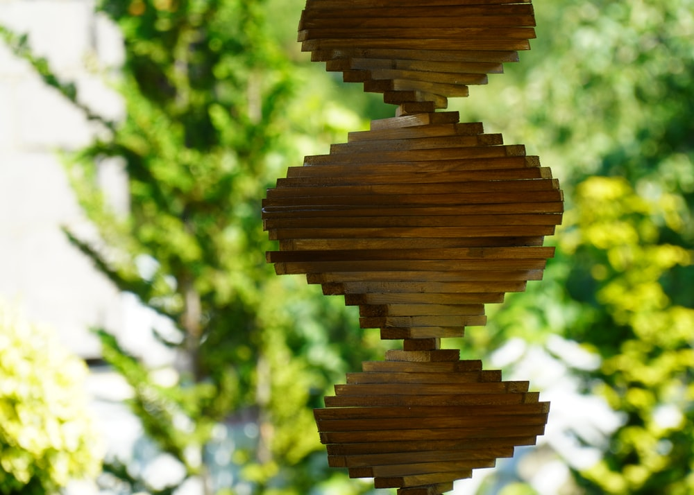 brown wooden round ornament in close up photography