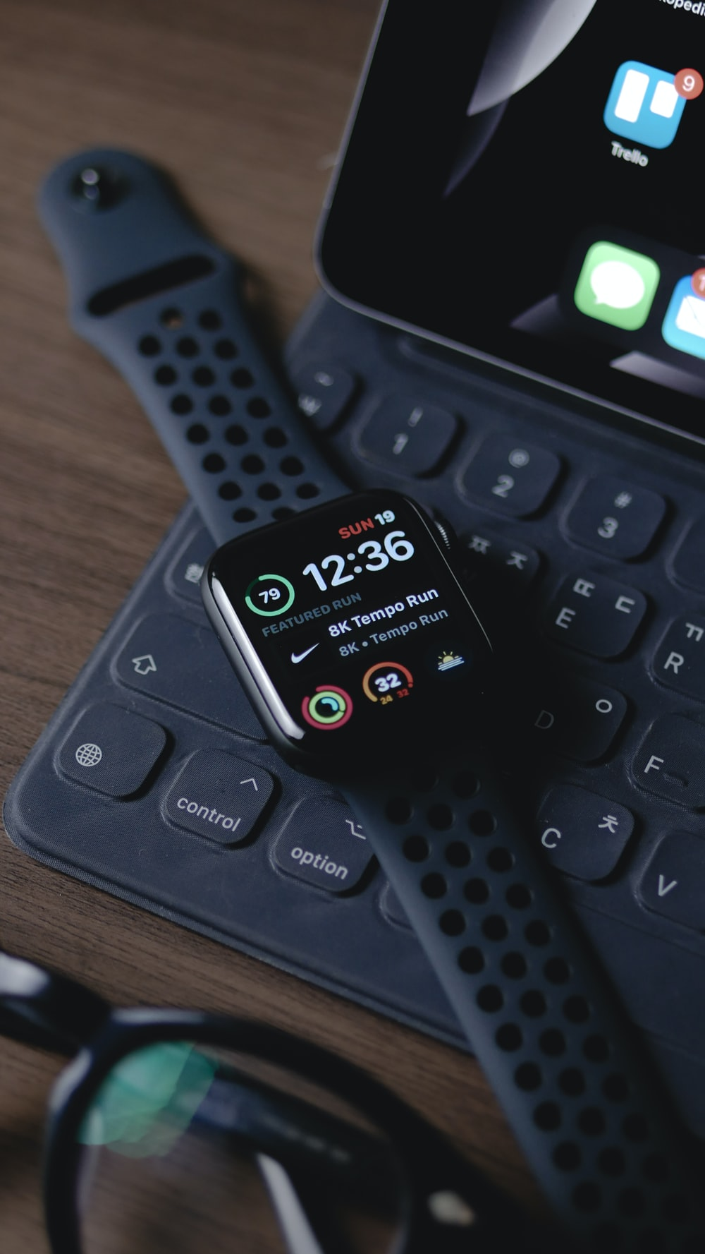 black smart watch on black computer keyboard