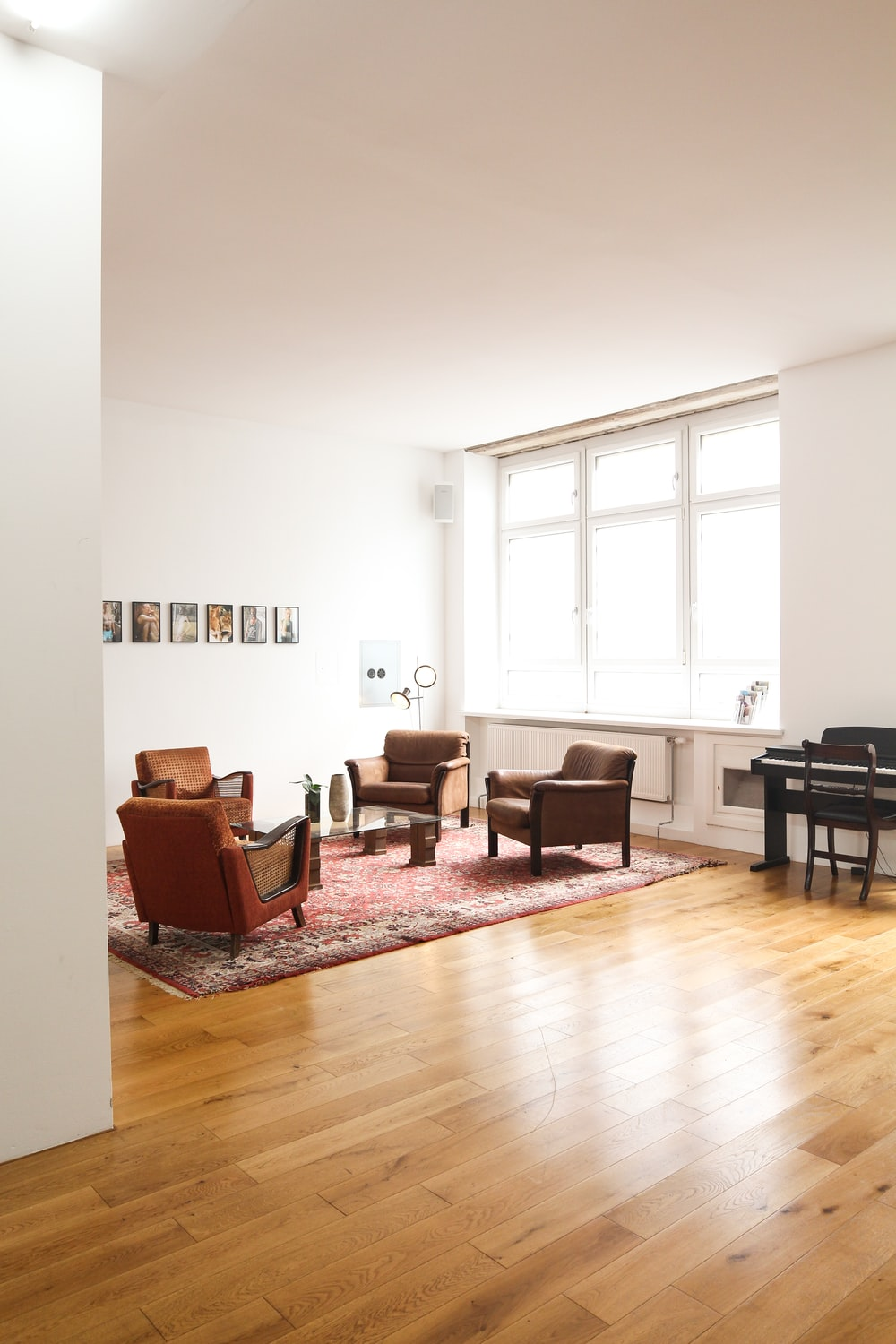living room with brown wooden parquet floor and white wall