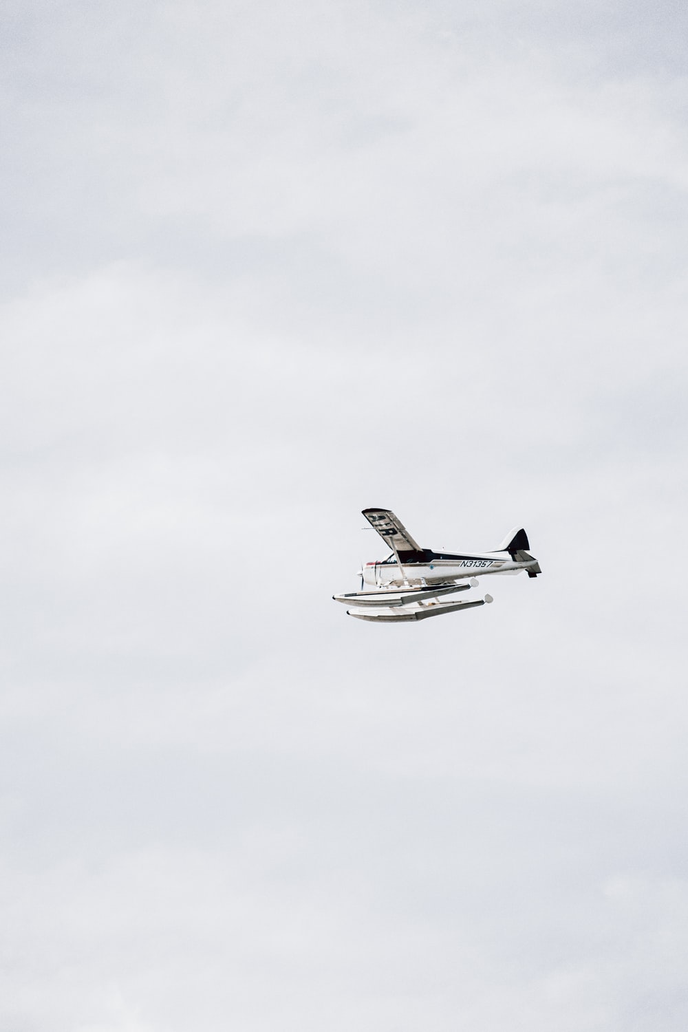 white and black airplane flying in the sky