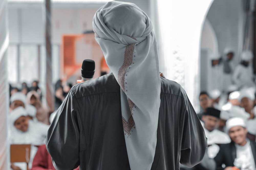 person in white hijab and black long sleeve shirt