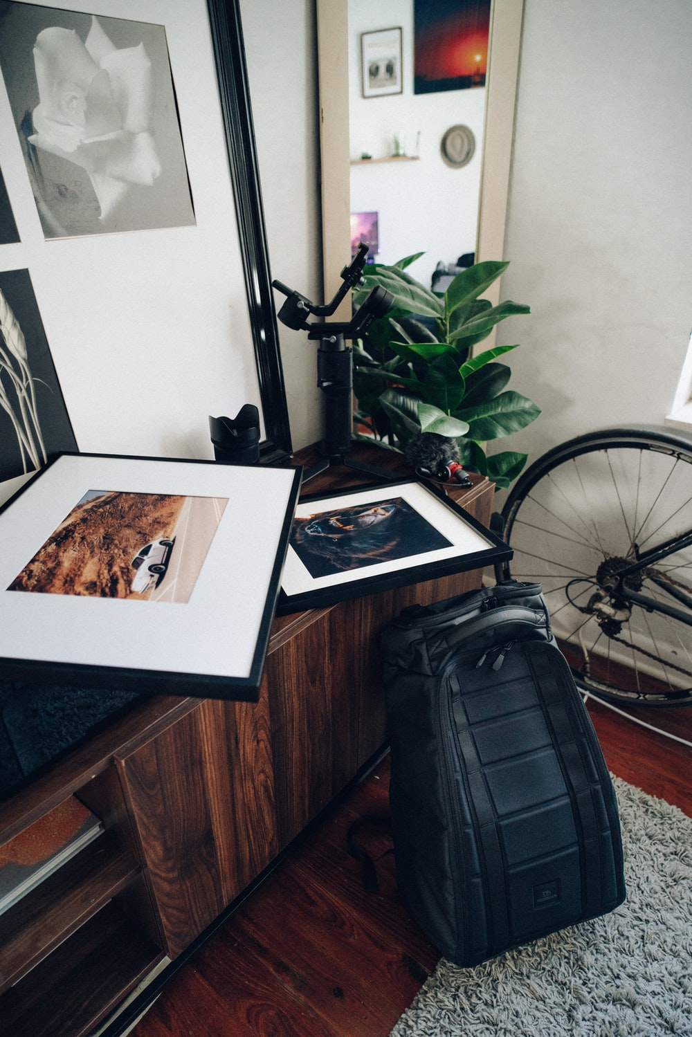 black backpack on brown wooden table
