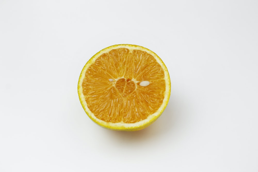 sliced orange fruit on white surface