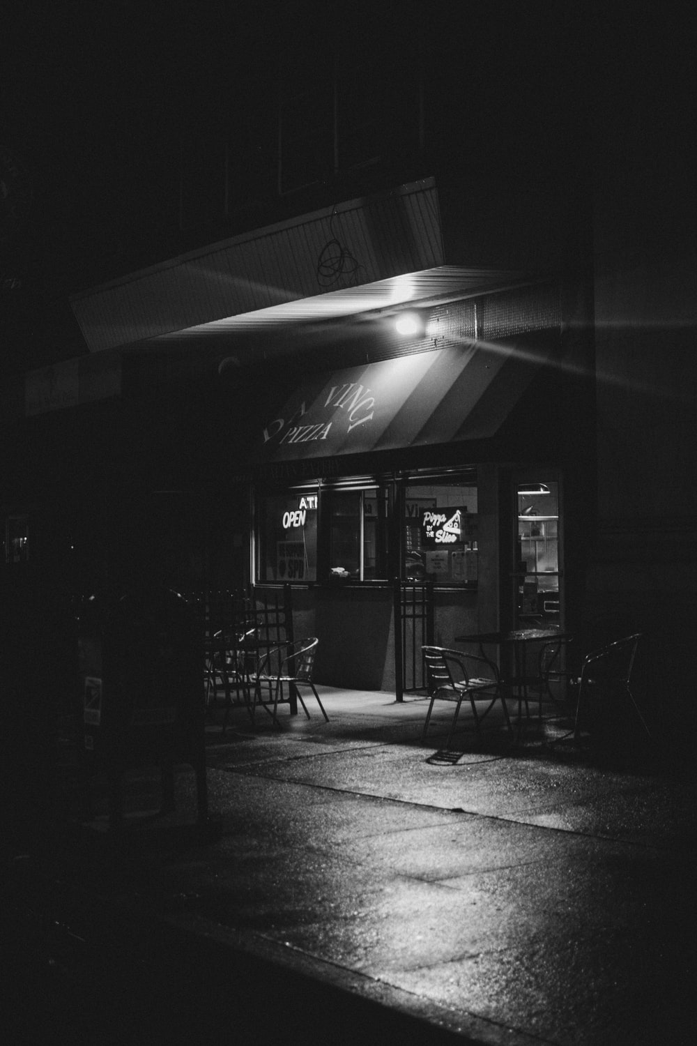grayscale photo of store front