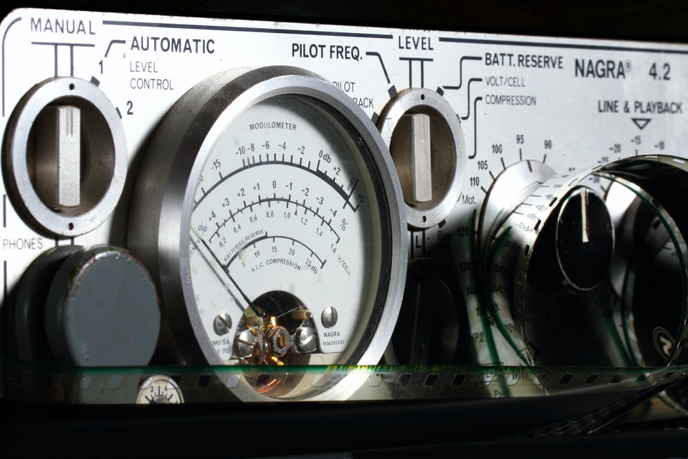white and silver gauge meter