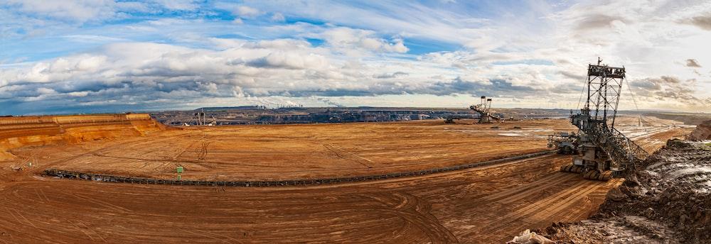 brown field under blue sky during daytime