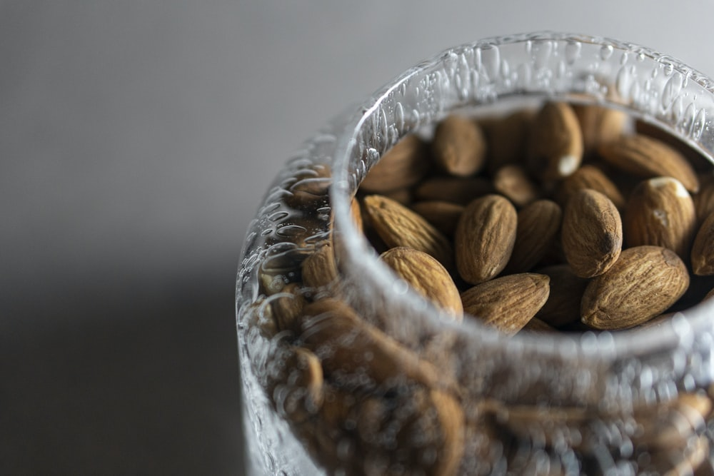 brown coffee beans in clear glass jar