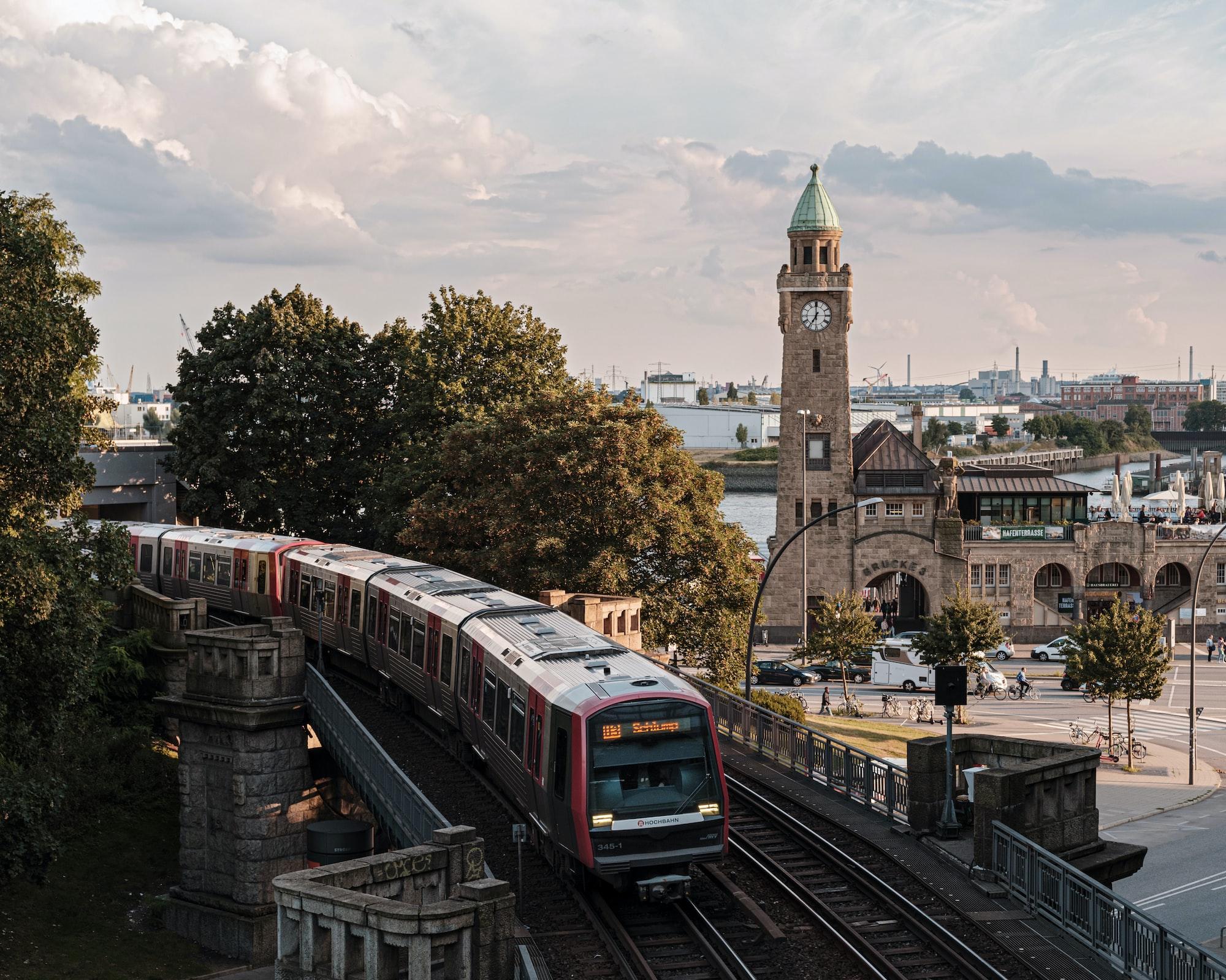 View on Hamburg hochbahn train and Landugsbrücke clock tower from above.