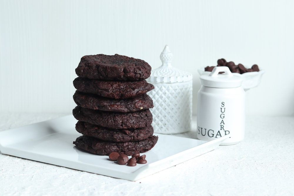 chocolate cookies on white ceramic plate
