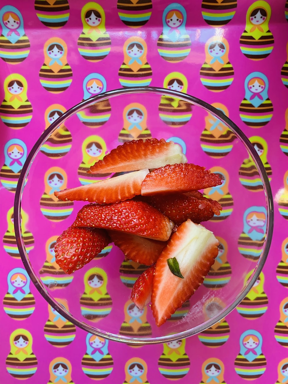 sliced orange fruit on purple and white ceramic plate