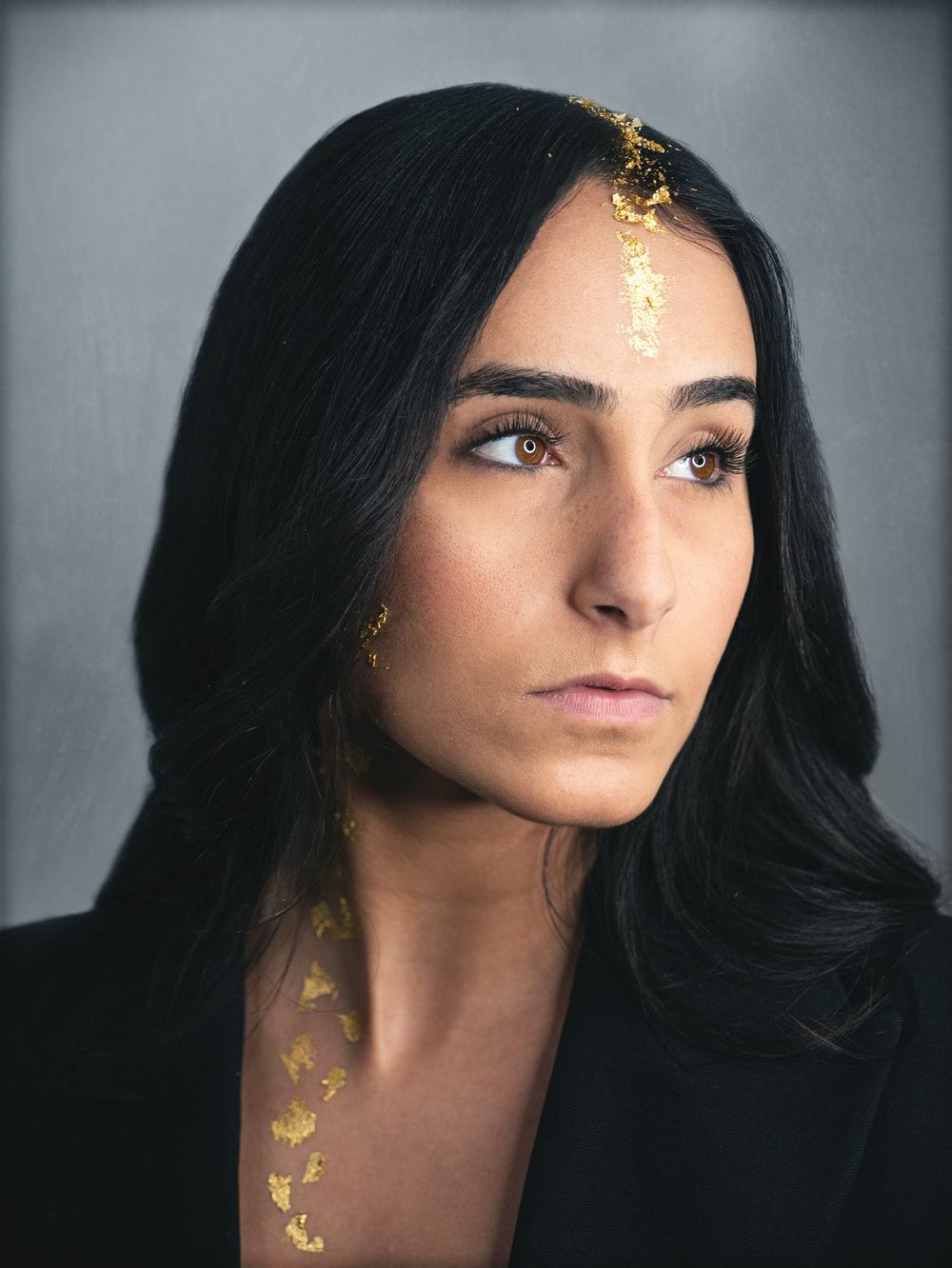 woman in black shirt with gold necklace