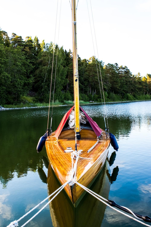 brown boat on lake during daytime