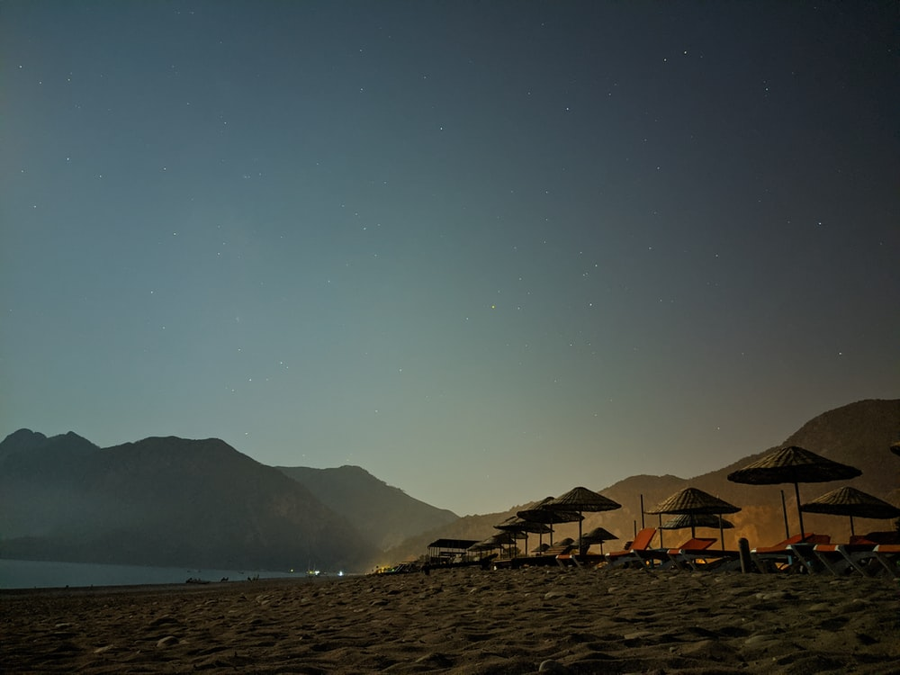 brown and white tent on beach during night time