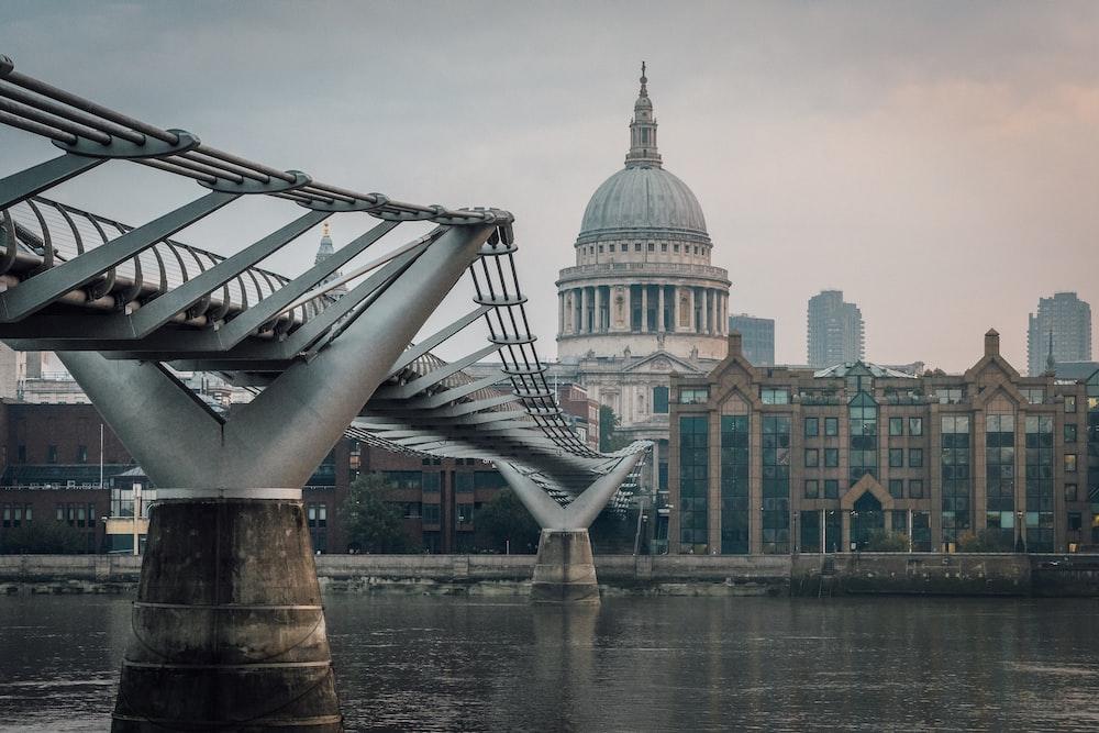 white bridge over river near city buildings during daytime