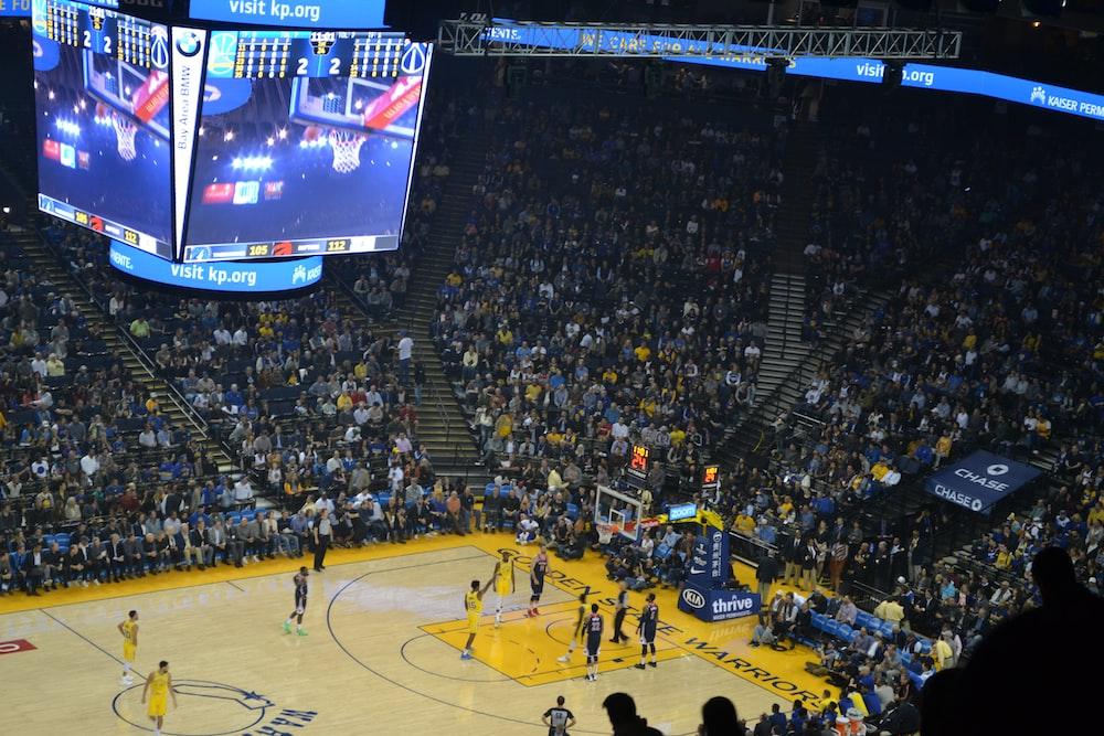 people watching basketball game on stadium