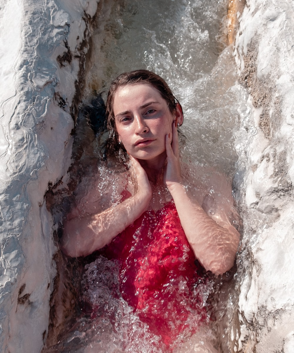 woman in red tube dress in water