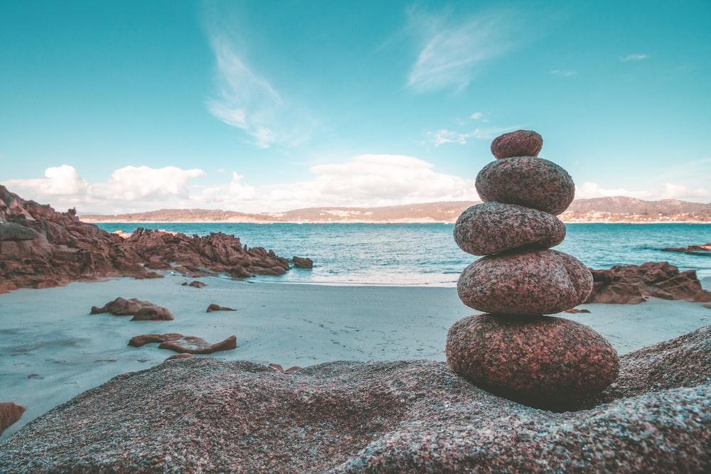 gray rocks on seashore during daytime