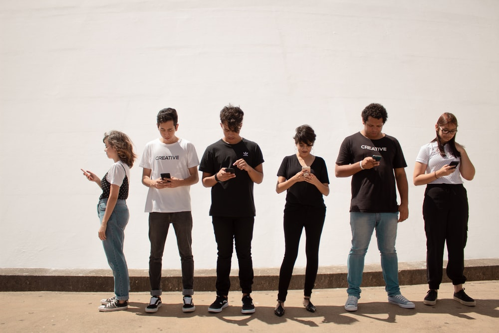 group of people standing on brown floor