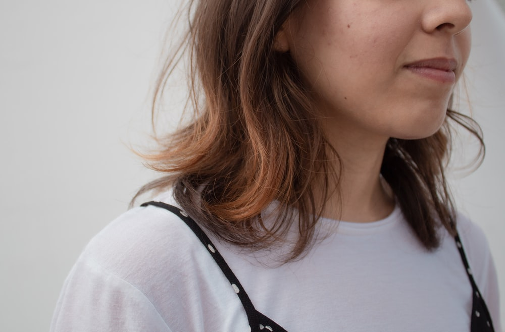 woman in white crew neck shirt