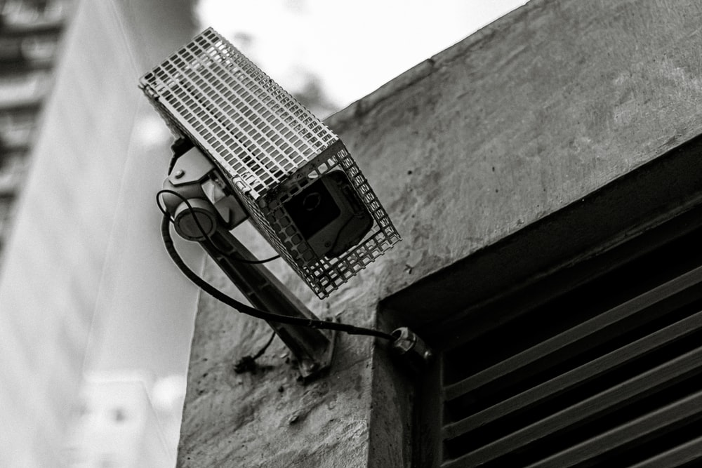 black and white electric device on gray concrete wall