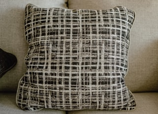 white and black throw pillow