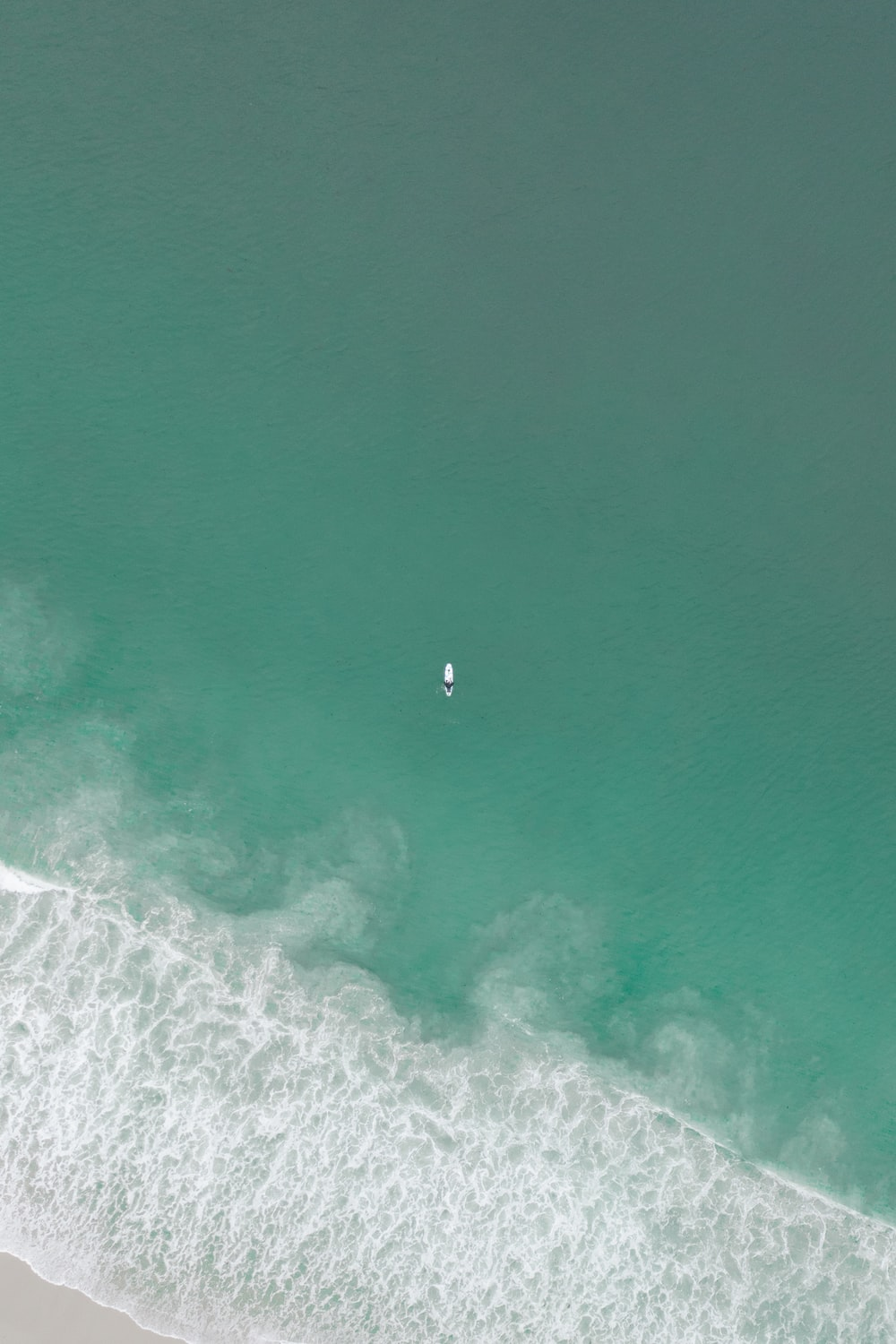 aerial view of person surfing on sea waves during daytime