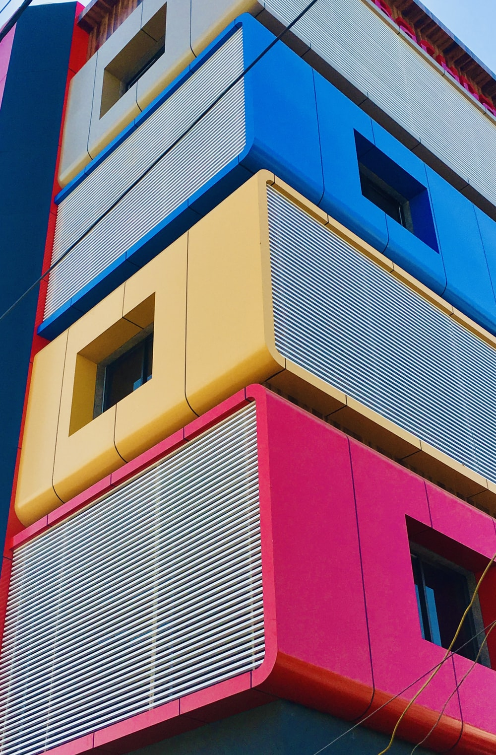 yellow blue and red concrete building