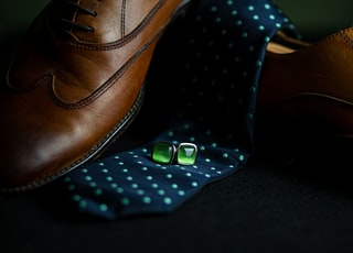 brown leather shoe with blue and white polka dot