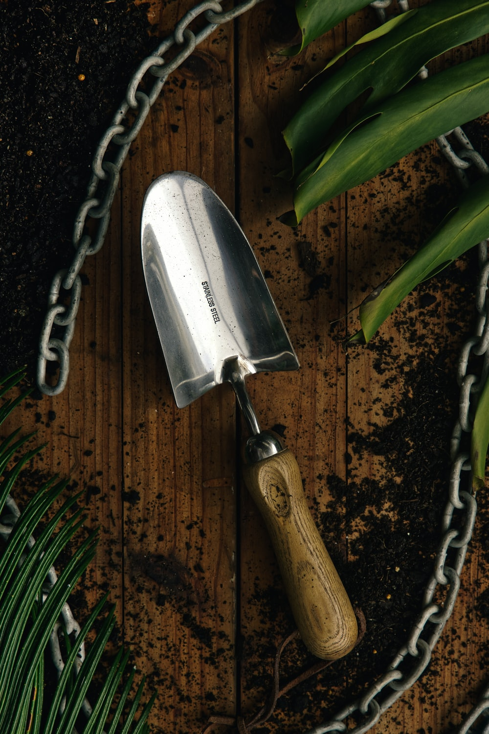 silver and brown steel hand tool
