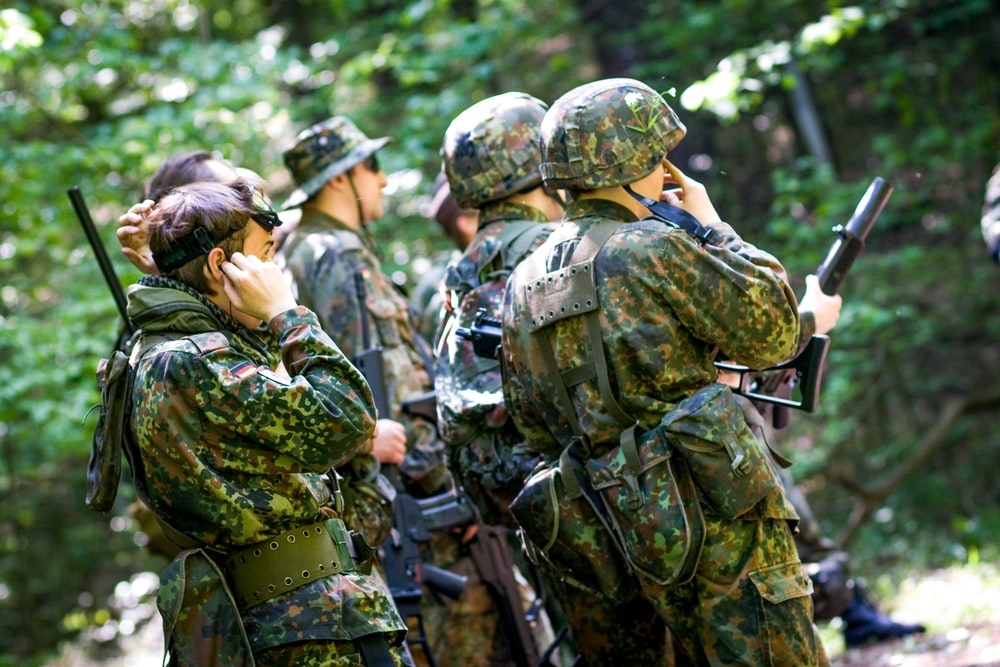 men in green and brown camouflage uniform