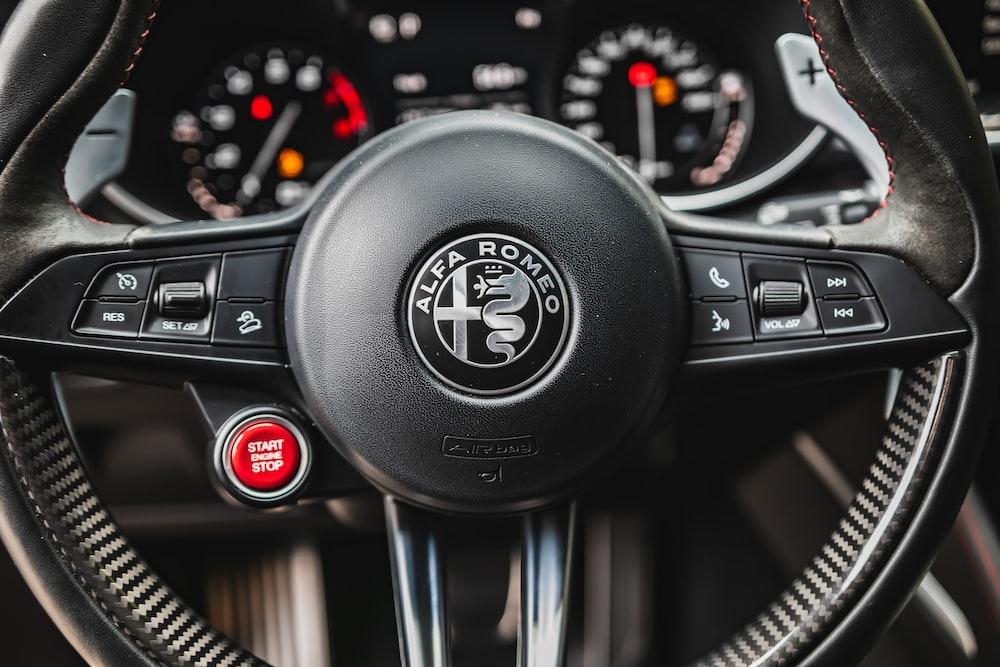 black volkswagen car steering wheel