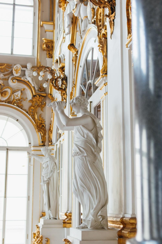 white angel ceramic figurine on white wooden table