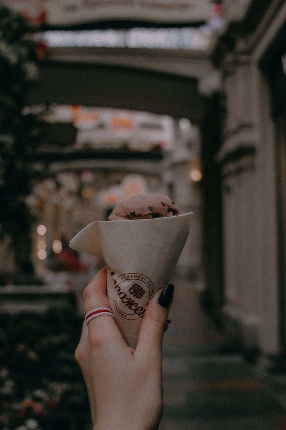 person holding ice cream cone