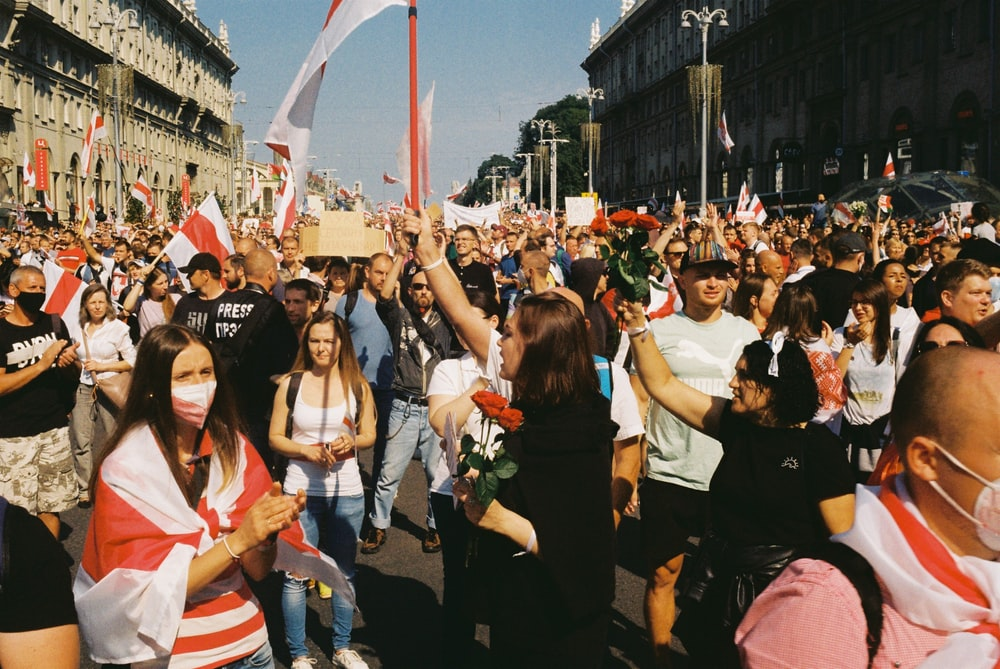 group of people holding flags during daytime