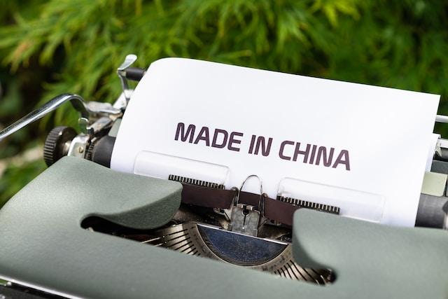 white and black typewriter on green grass during daytime