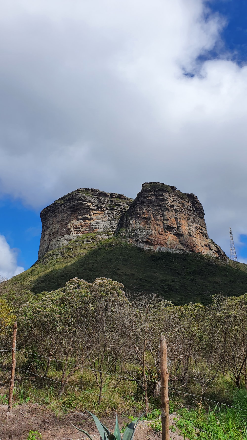 green and brown rock formation under white clouds during daytime