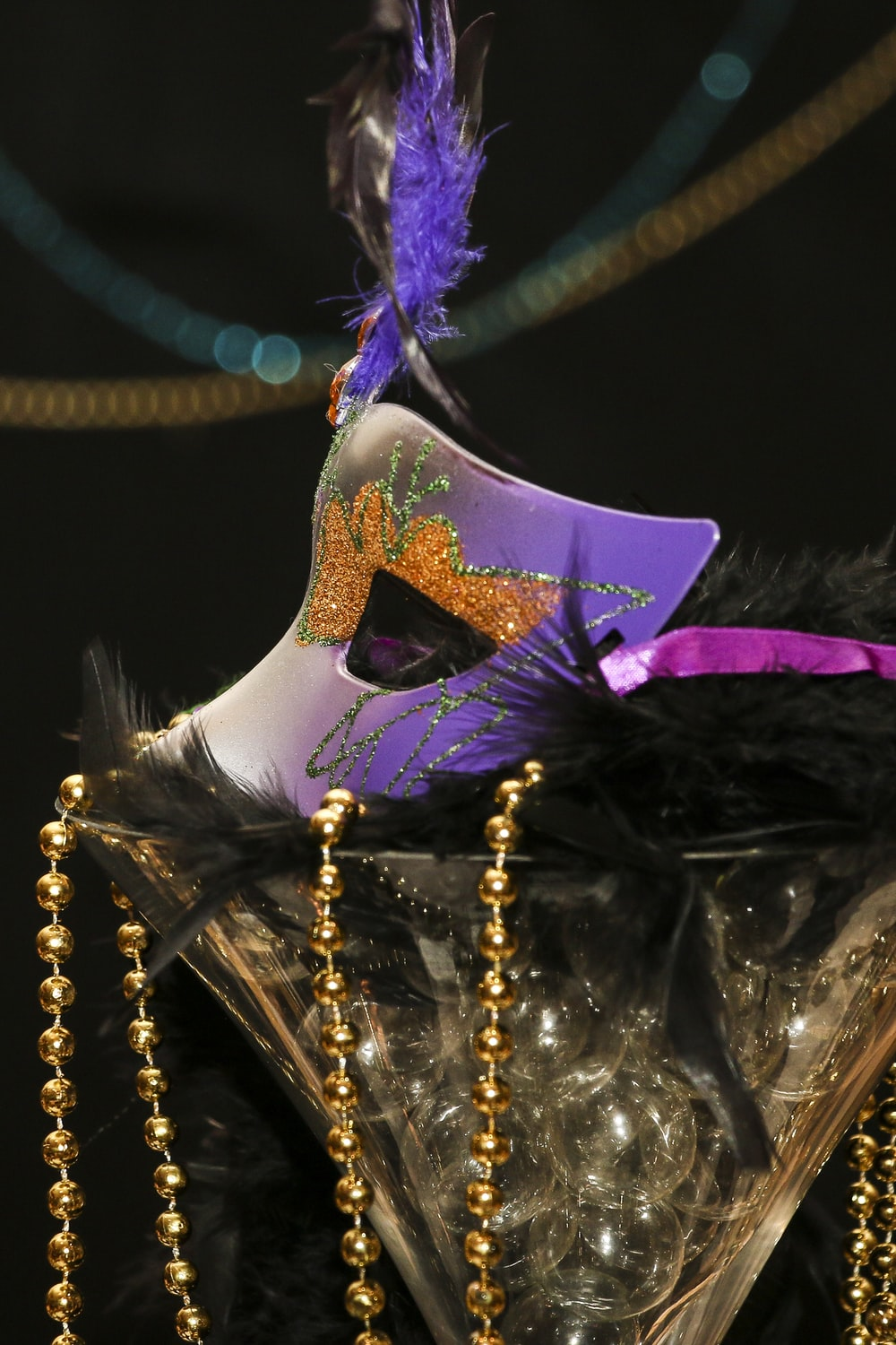 purple and gold crown with purple ribbon