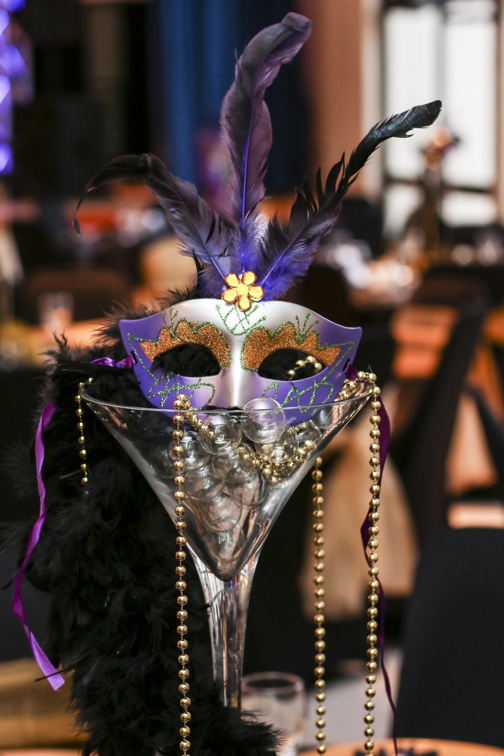purple and white masquerade mask