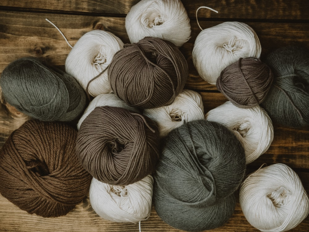 brown and white yarn rolls