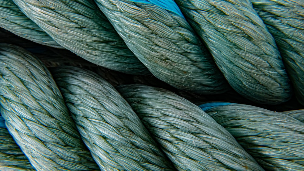 green and blue rolled textile