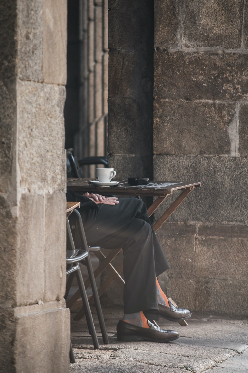 black and gray folding table beside brown concrete wall