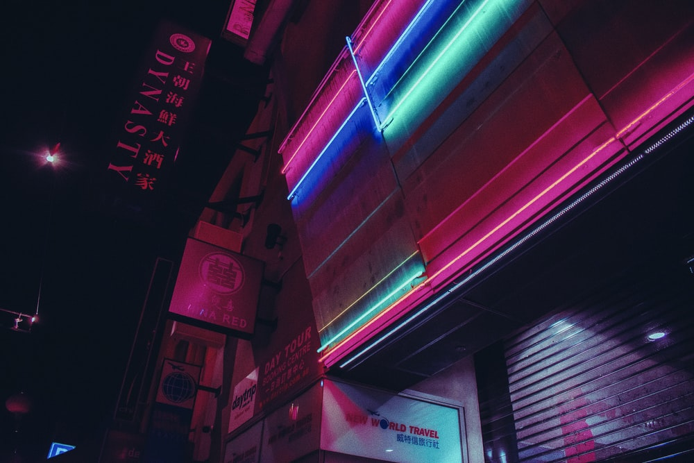 red and blue neon light signage