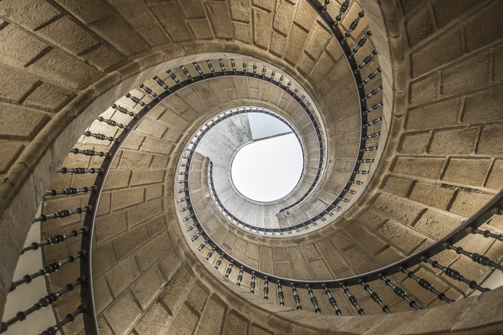 brown spiral staircase during daytime