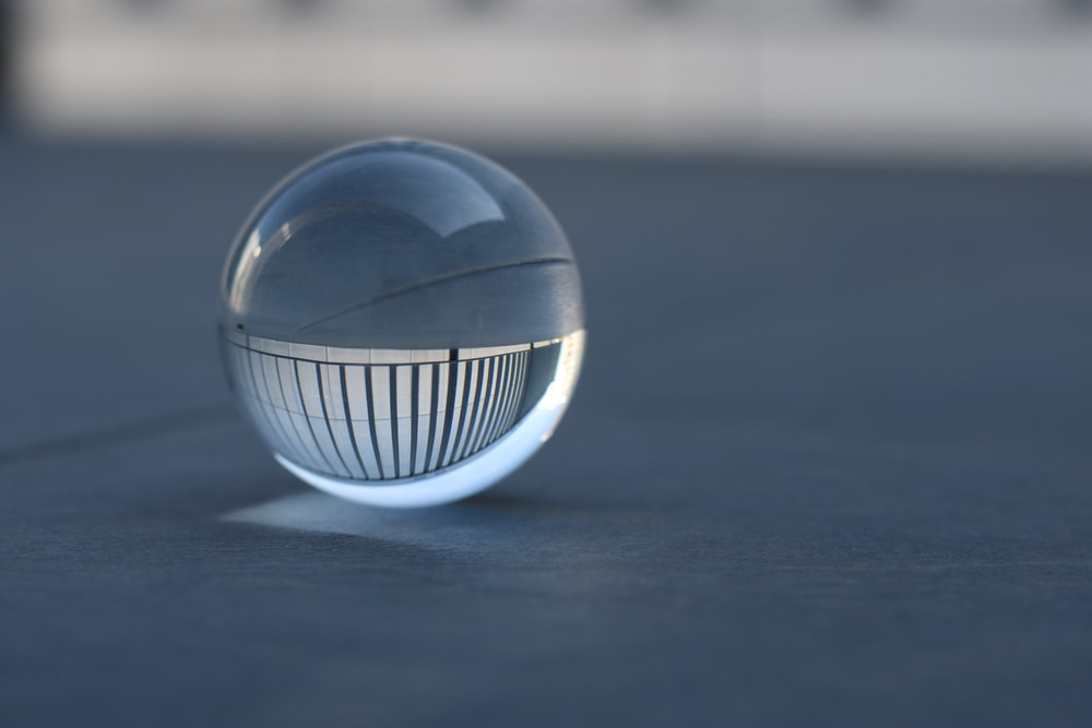 white and blue ball on white surface