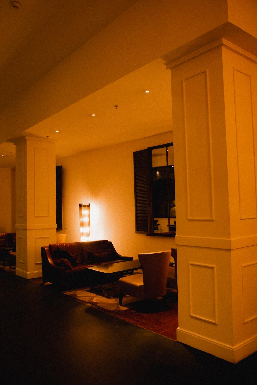 black sofa chair near white wooden cabinet