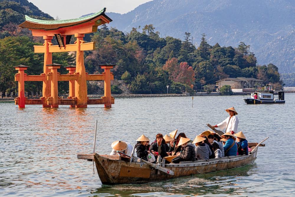 people riding boat on lake during daytime