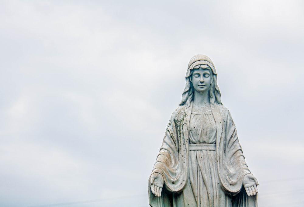 gray concrete statue of a man