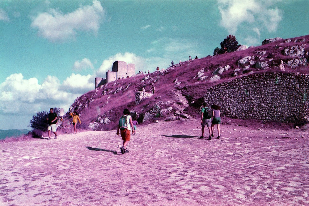 people walking on white sand during daytime